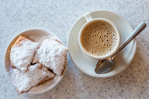 Beignets: powdered sugar covered fried dough greatness