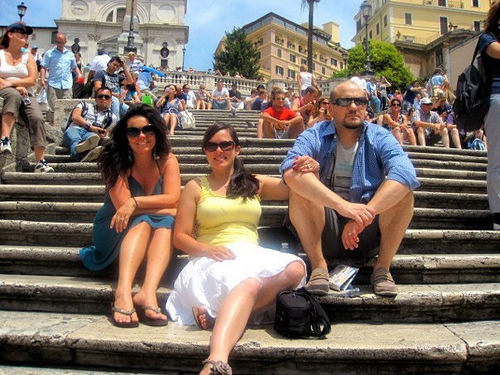 Joyce taking a break from exploring by sitting on the Spanish Steps in Rome