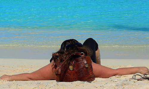 Joyce relaxing on a beach in her favorite destination,  French Polynesia