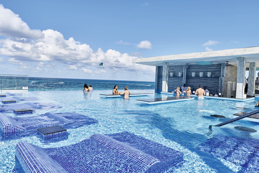Infinity pool with swim up bar at Riu Palace Paradise Island