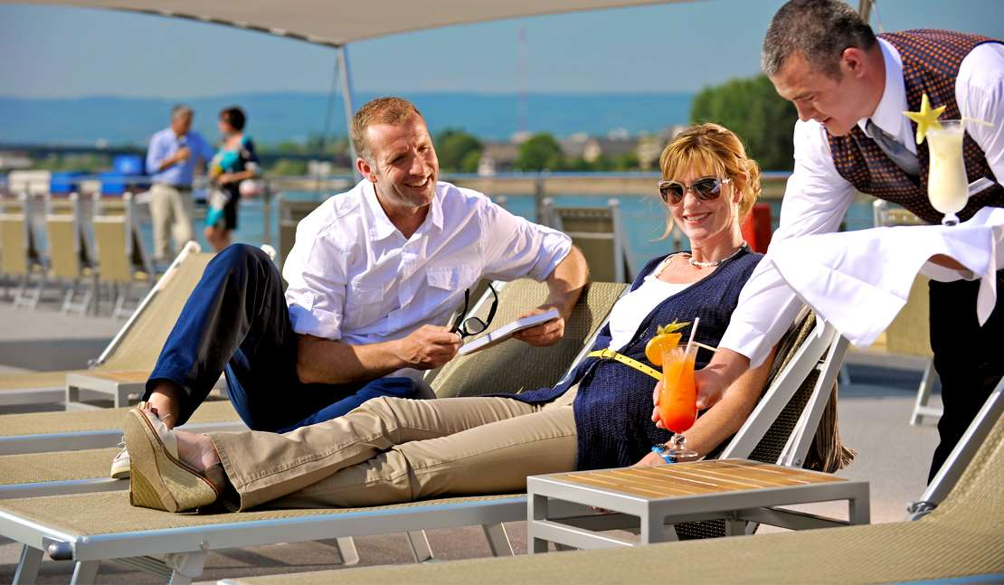 Enjoy ever changing view from the top deck of your river cruise