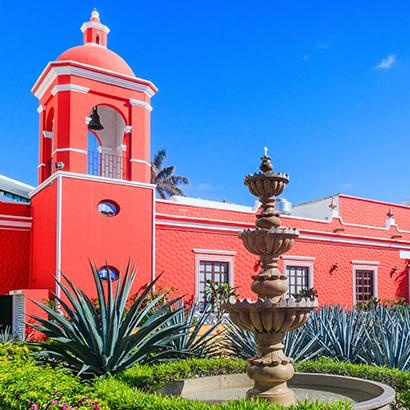 Colonial building at aloe vera plantation in Cancun, Mexico