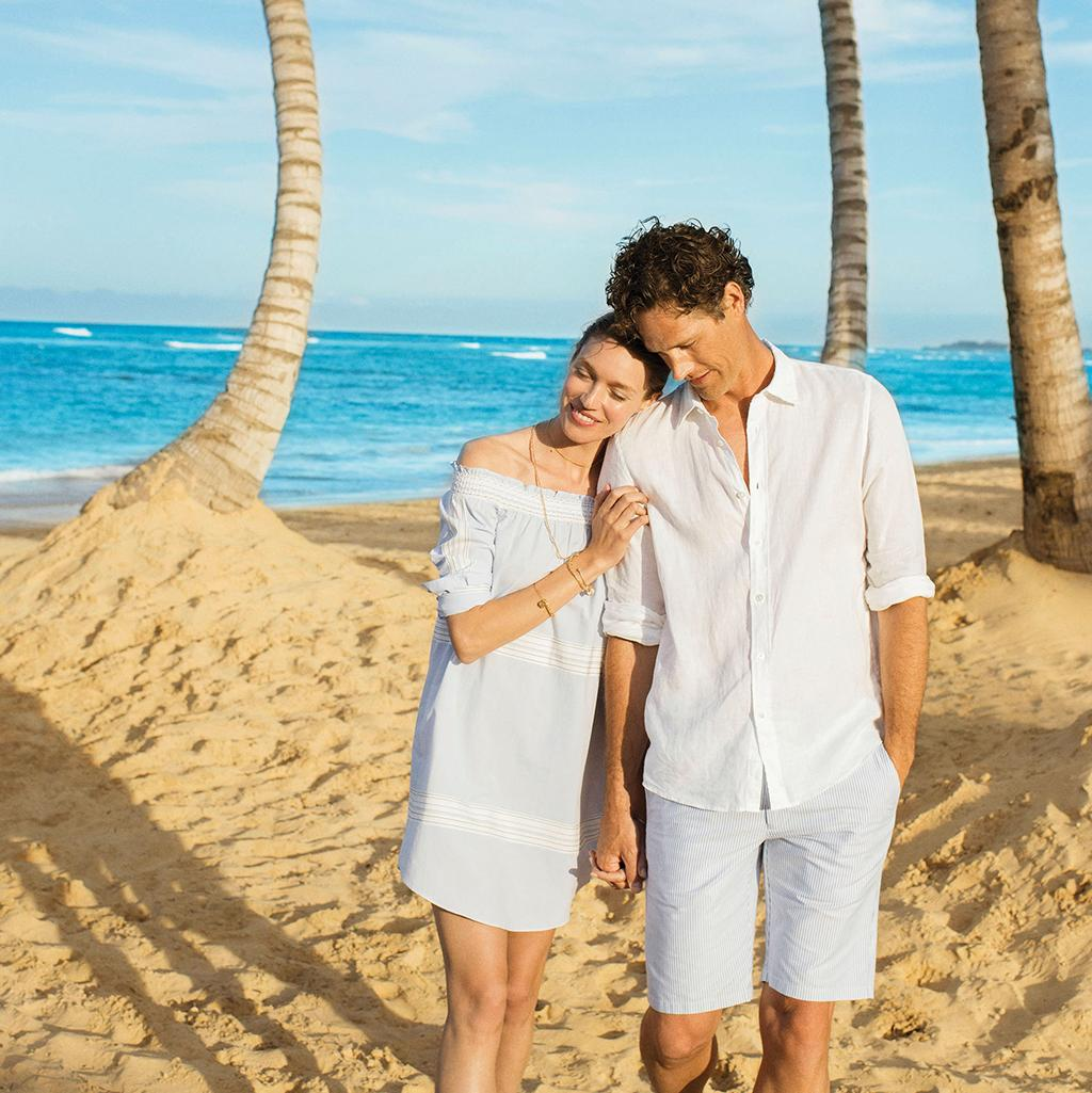 couple walking arm in arm on a vacation to an Excellence resort