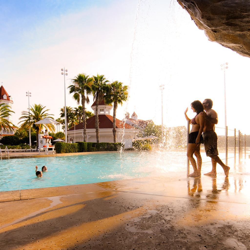 family enjoying poolside fun at Disney's Grand Floridian