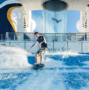 young man riding a wave machine aboard a Royal Caribbean cruise
