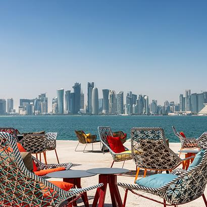 colorful seating on a patio overlooking Doha, Qatar