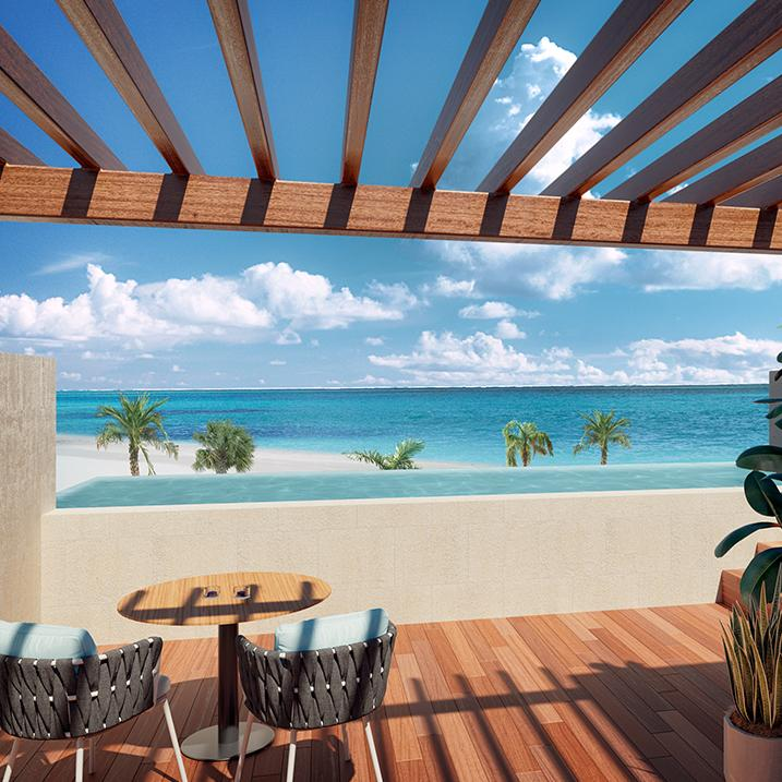 ocean views from a patio overlooking the beach at Majestic Elegance Playa Mujeres