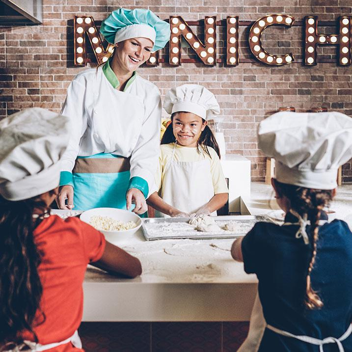 kids cooking with a chef at an Iberostar Resort