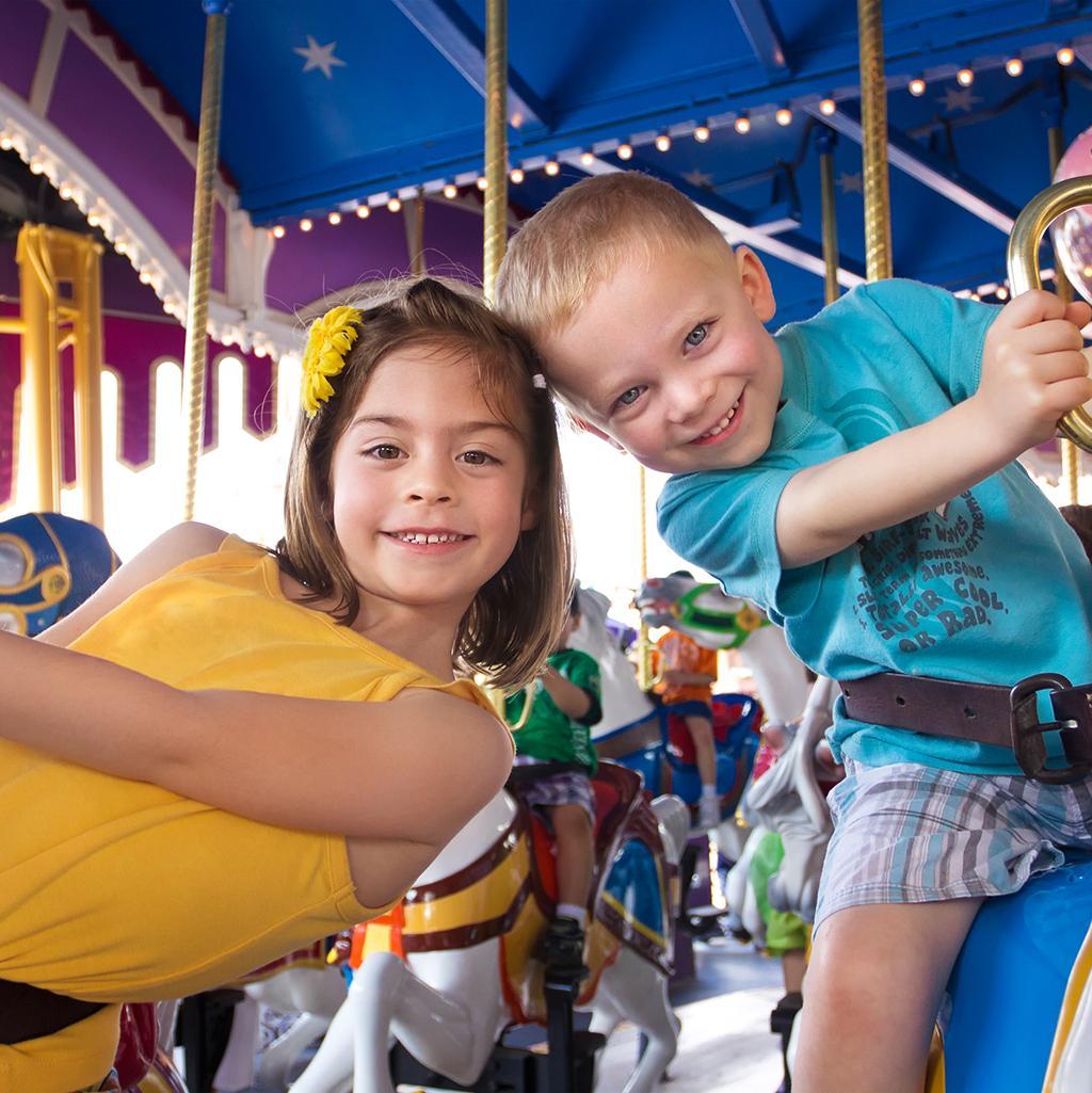 Children riding on a merry-go-round at Disneyland in Anaheim California