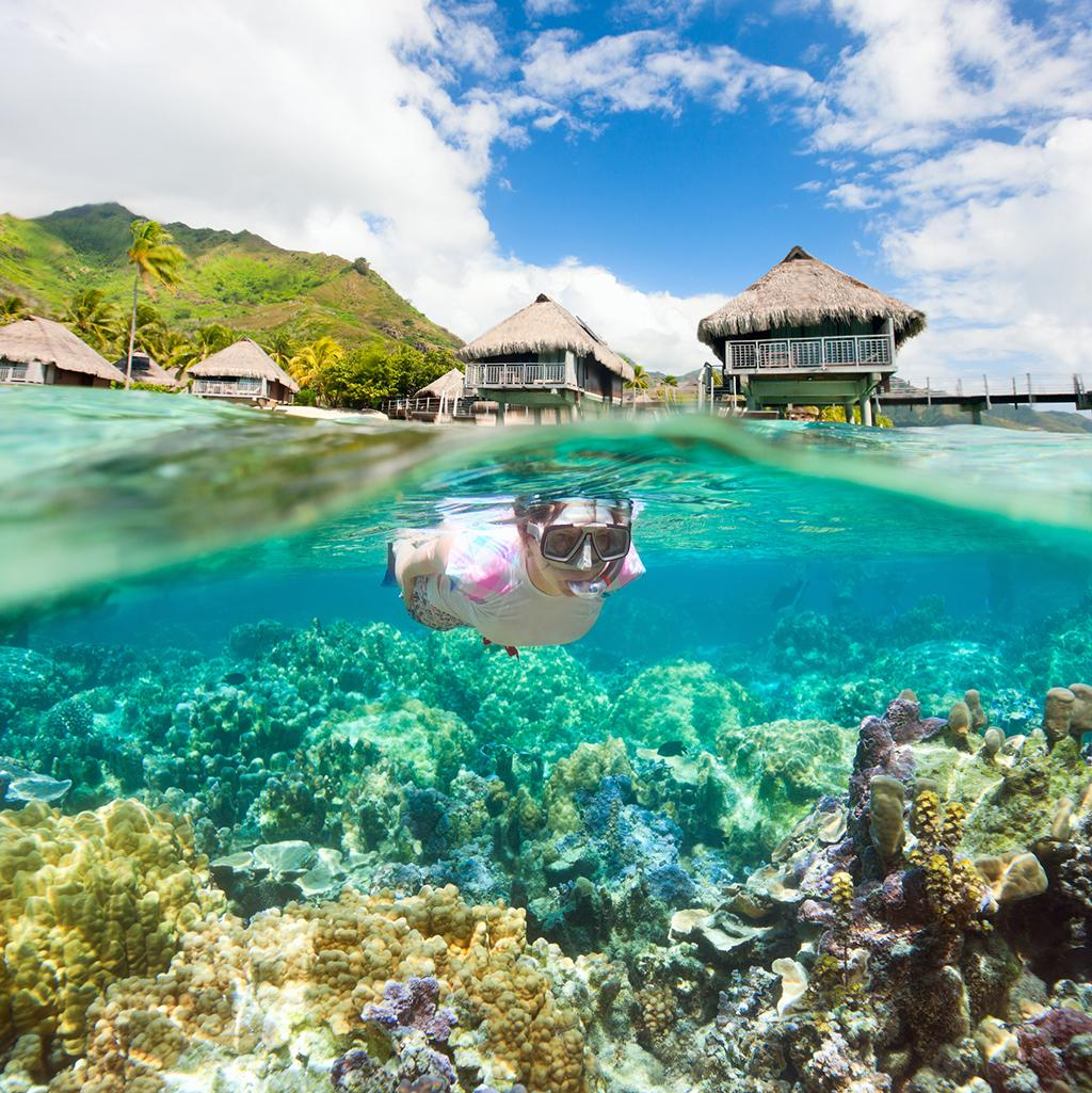 Snorkeling from overwater bungalows in Bora Bora
