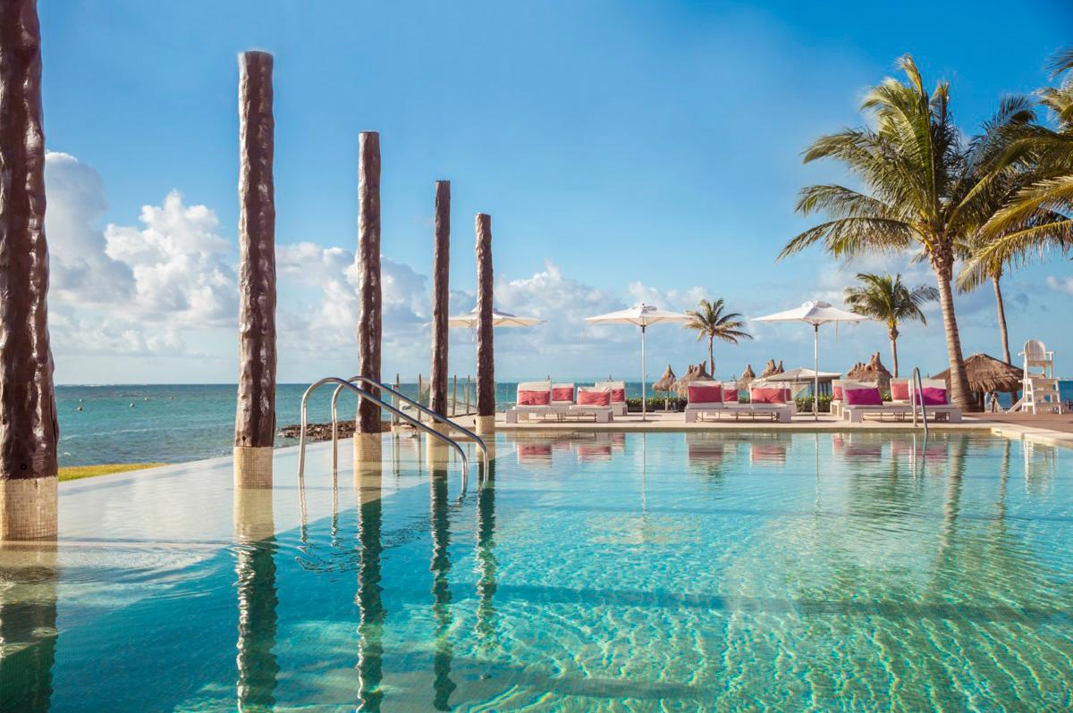 Beautiful sunbathing infinity pool at Club Med All-Inclusive resort