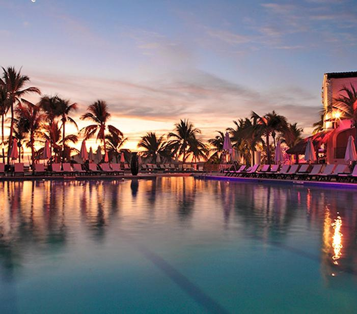 Sunset over Club Med's tropical pool facilities