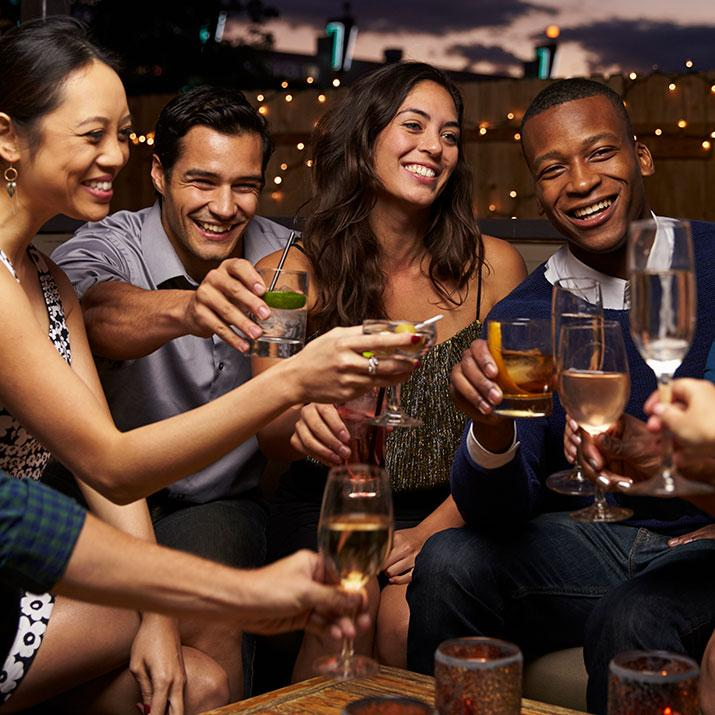 Group of young adults share in a champagne toast on an evening out