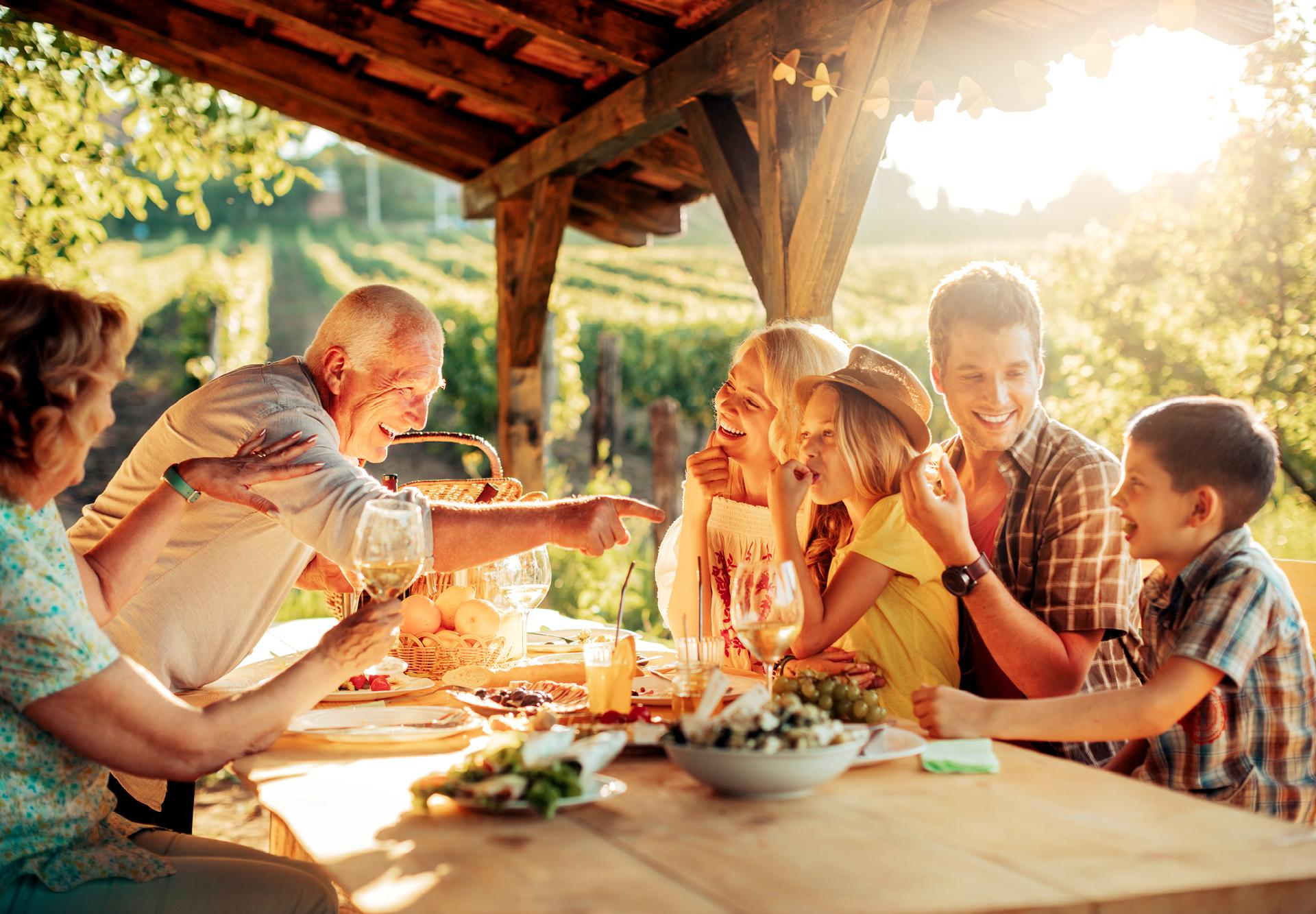 Family laughs are best around a dinner table in Italian vineyards