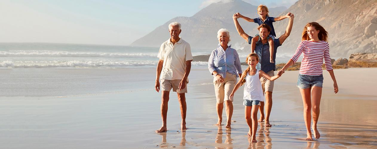 Family spanning three generations on a beach getaway