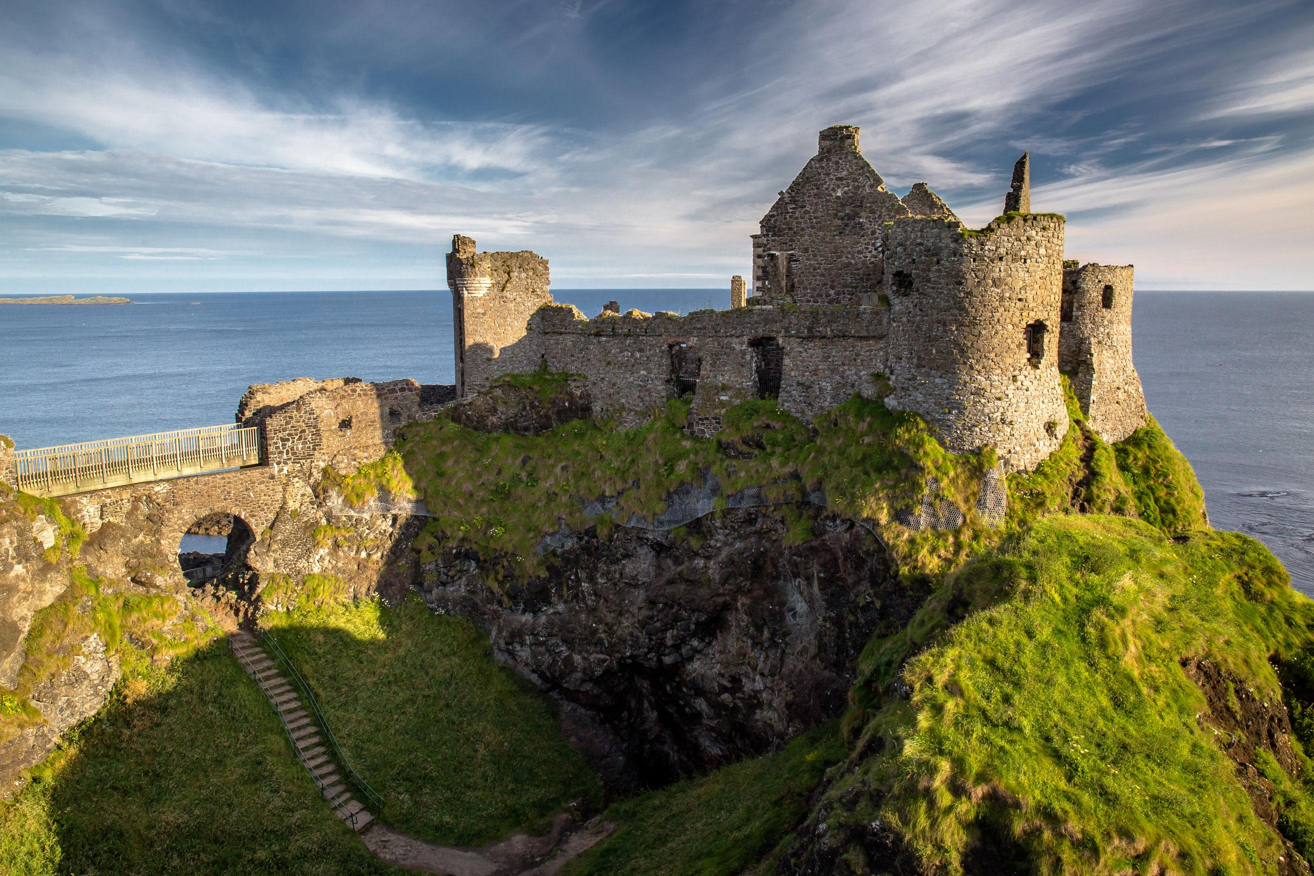View of the ruins of Dunluce castle with an Ireland vacation package