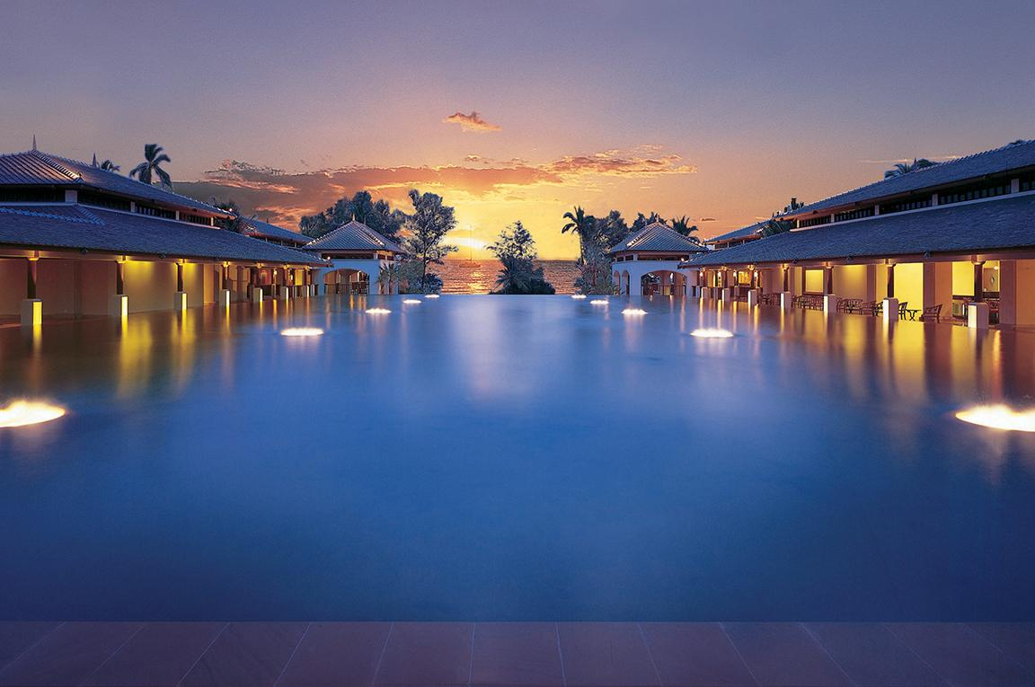 View the sunrise from luxury infinity pools like at the JW Marriott Phuket Resort & Spa