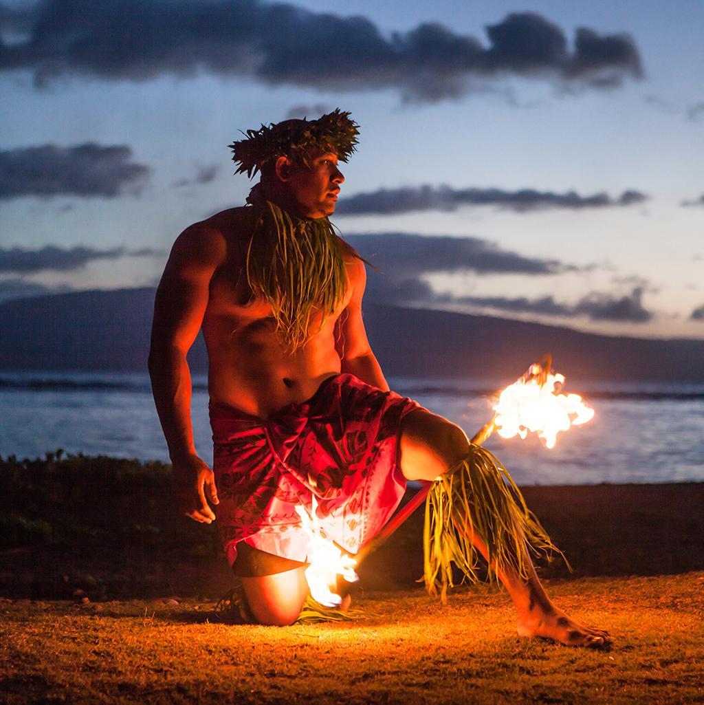 Native Hawaiian fire dancer in Kauai