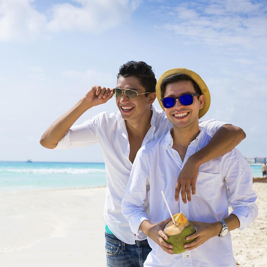 Gay couple at LGBT friendly beach resort