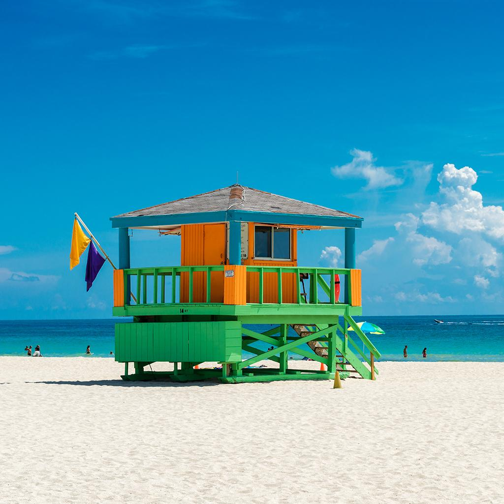 brightly colored lifeguard tower on a sunny beach