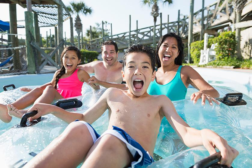 A family having fun on vacation on a waterslide