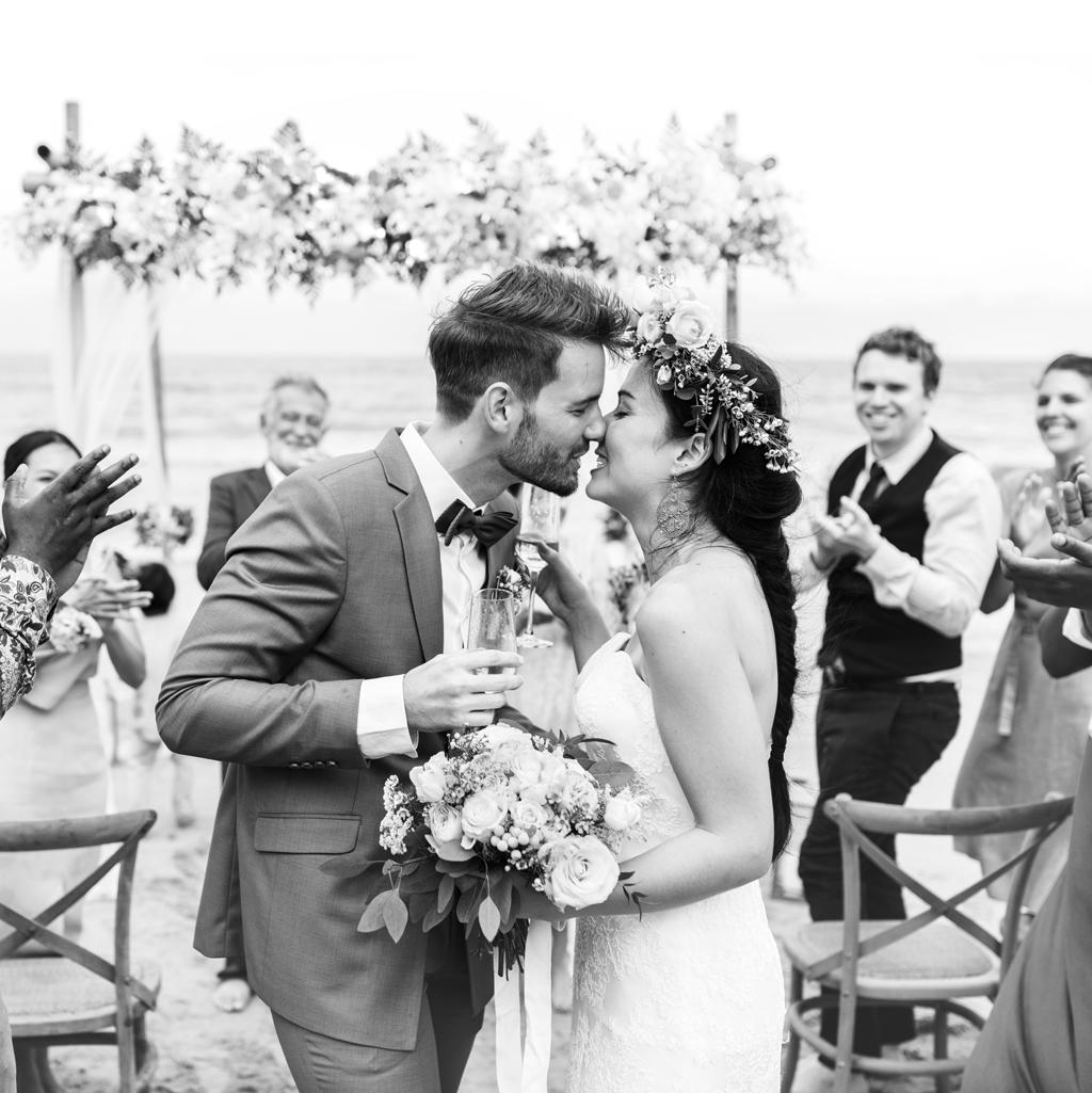 couple about to kiss after having exchanged wedding vows at their destination wedding