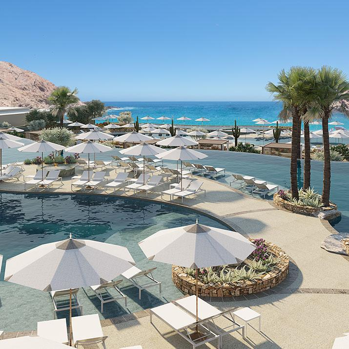 Lounge chairs and umbrellas around pools in Los Cabos, Mexico