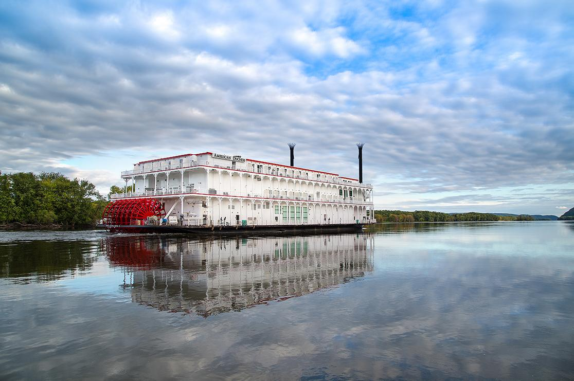 A traditional Louisiana paddle wheel cruise boat on a river