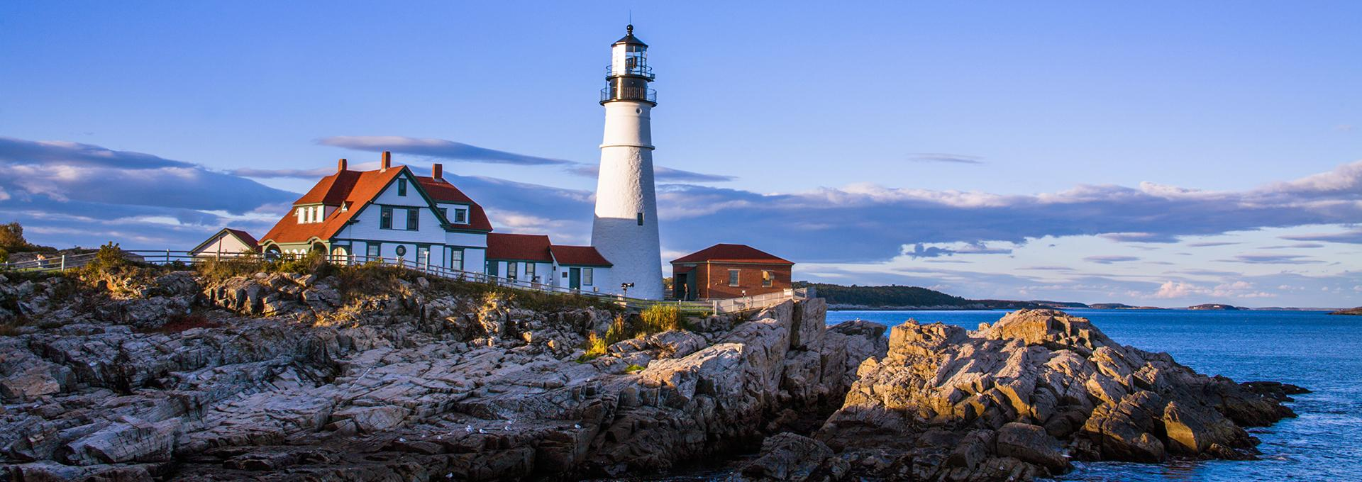 Scenic coastline with a view of a lighthouse in Maine