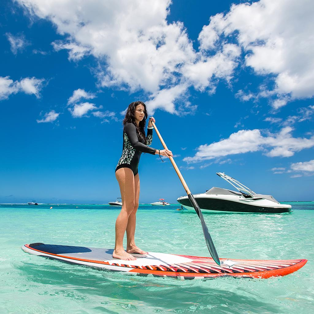 Go paddle boarding with Liberty Travel's Mauritius vacation packages