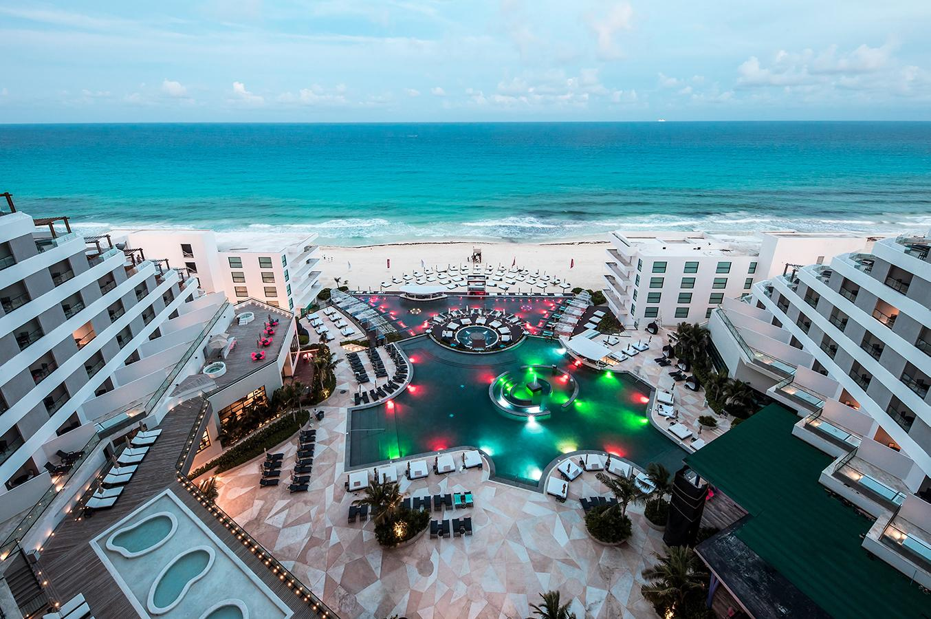 Aerial view of MelodyMaker Cancun's beachside pool amenities