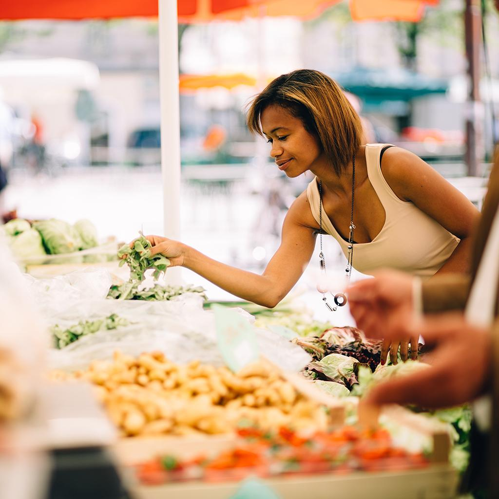 Girl shopping at local market in Montreal