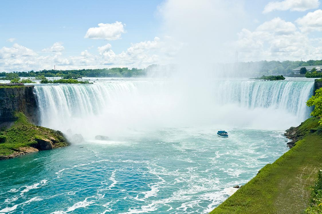 Views of the misty Niagara Falls on a summer day