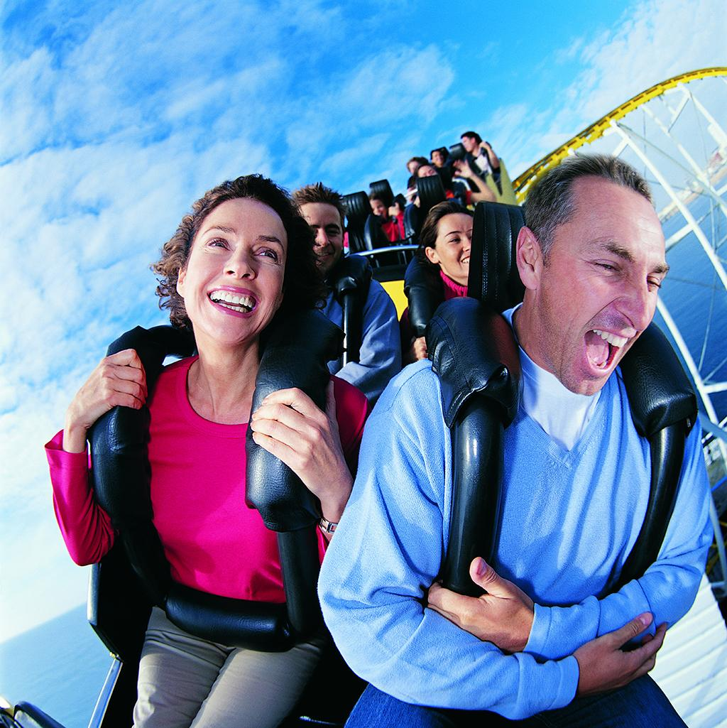 Couple riding a roller coaster in Orlando Florida