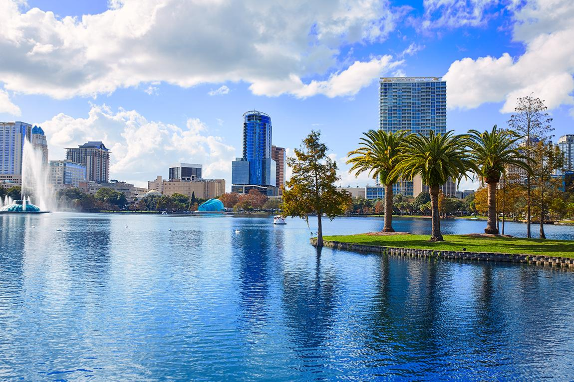 Sunny views of orlando's city with fountains and palm trees