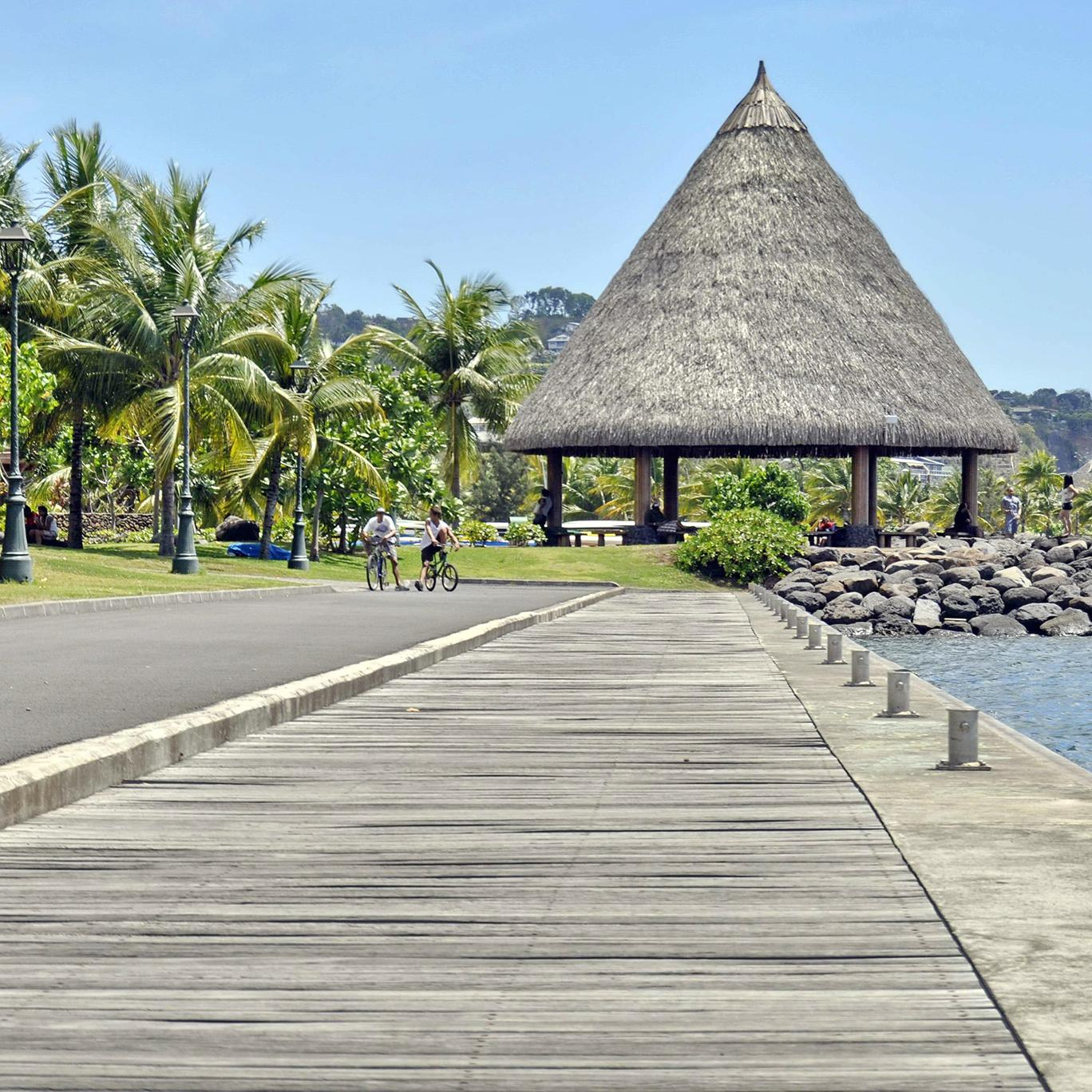 Biking along the coastline of Papeete, Tahiti