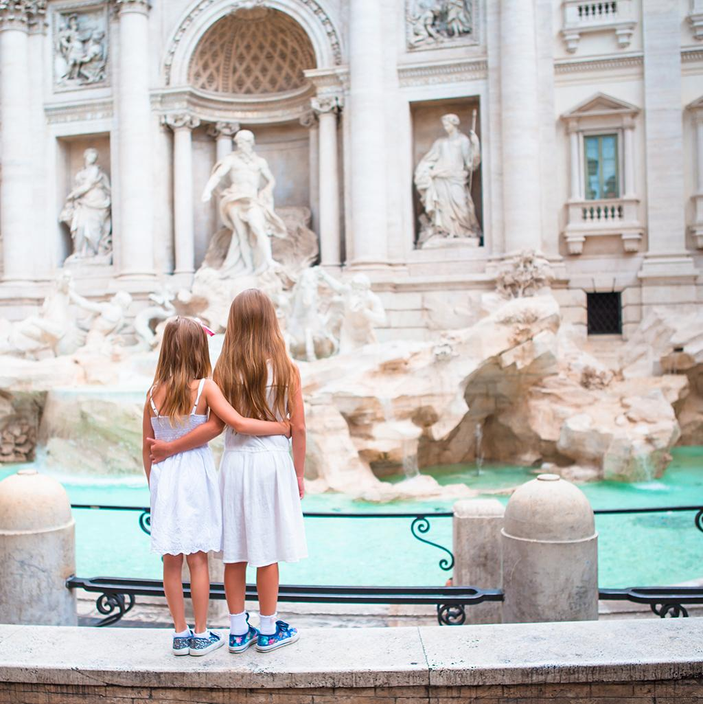 tourists at the Trevi fountain in Rome