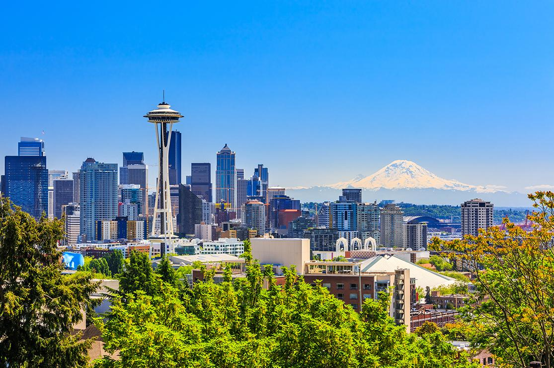 views of Seattle's space needle and mountainous landscape