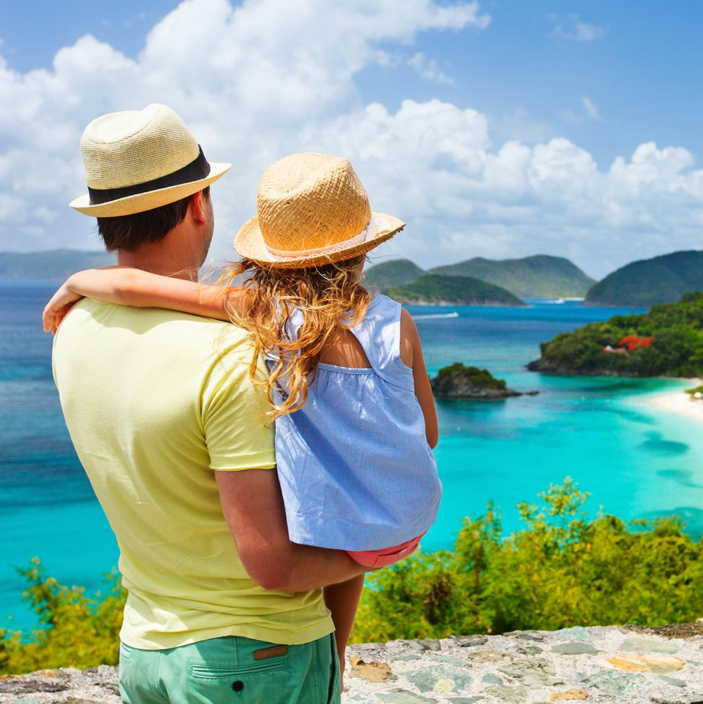 Father and child overlooking St. John's coastline