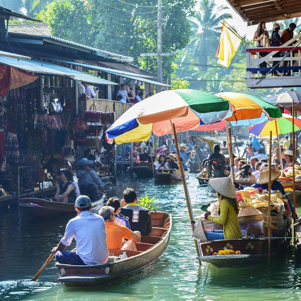 Paddle down open market canals with Thailand vacations