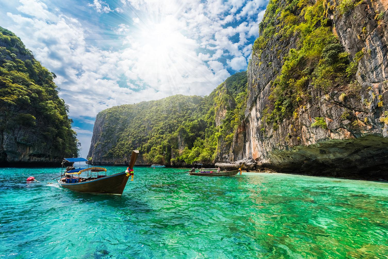 Experience boat tours through rocky inlets with Thailand vacation packages