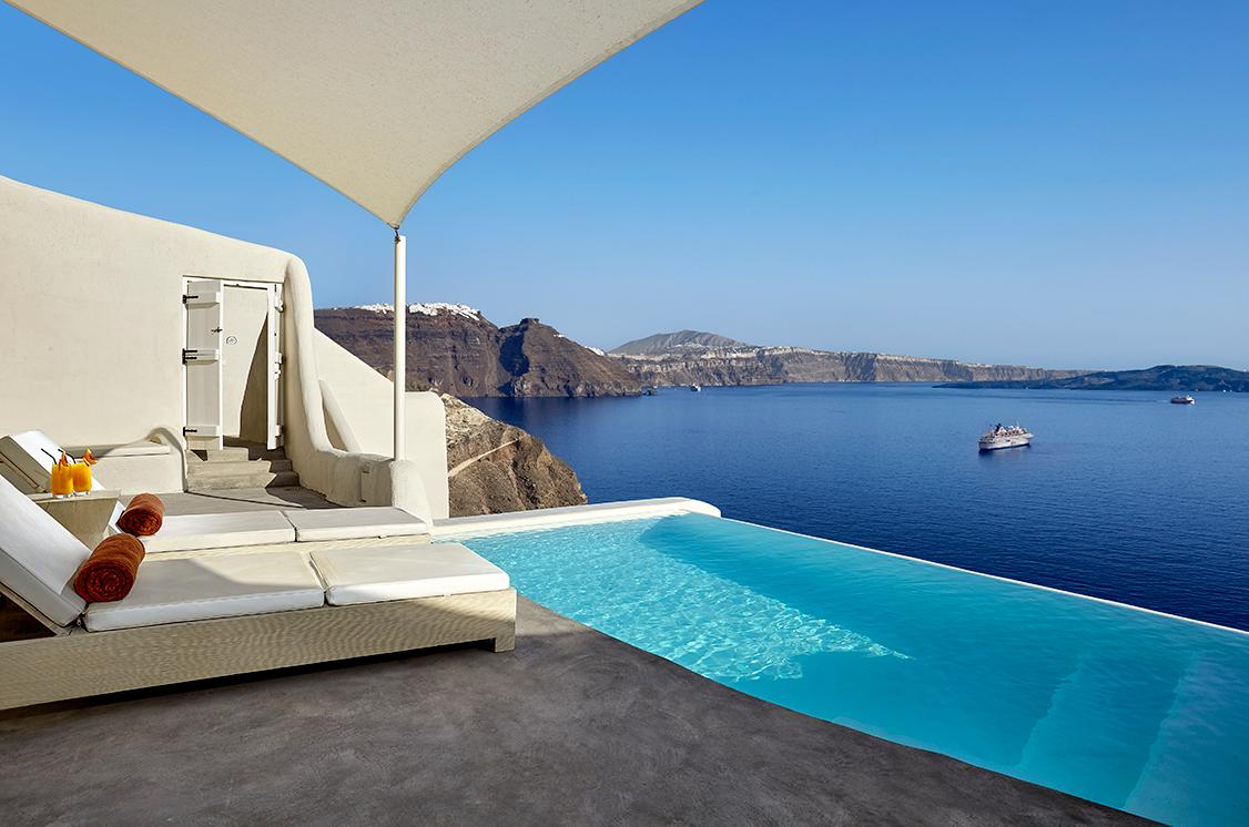 Sit by the pool in accommodations with stunning views at the Luxury Collection