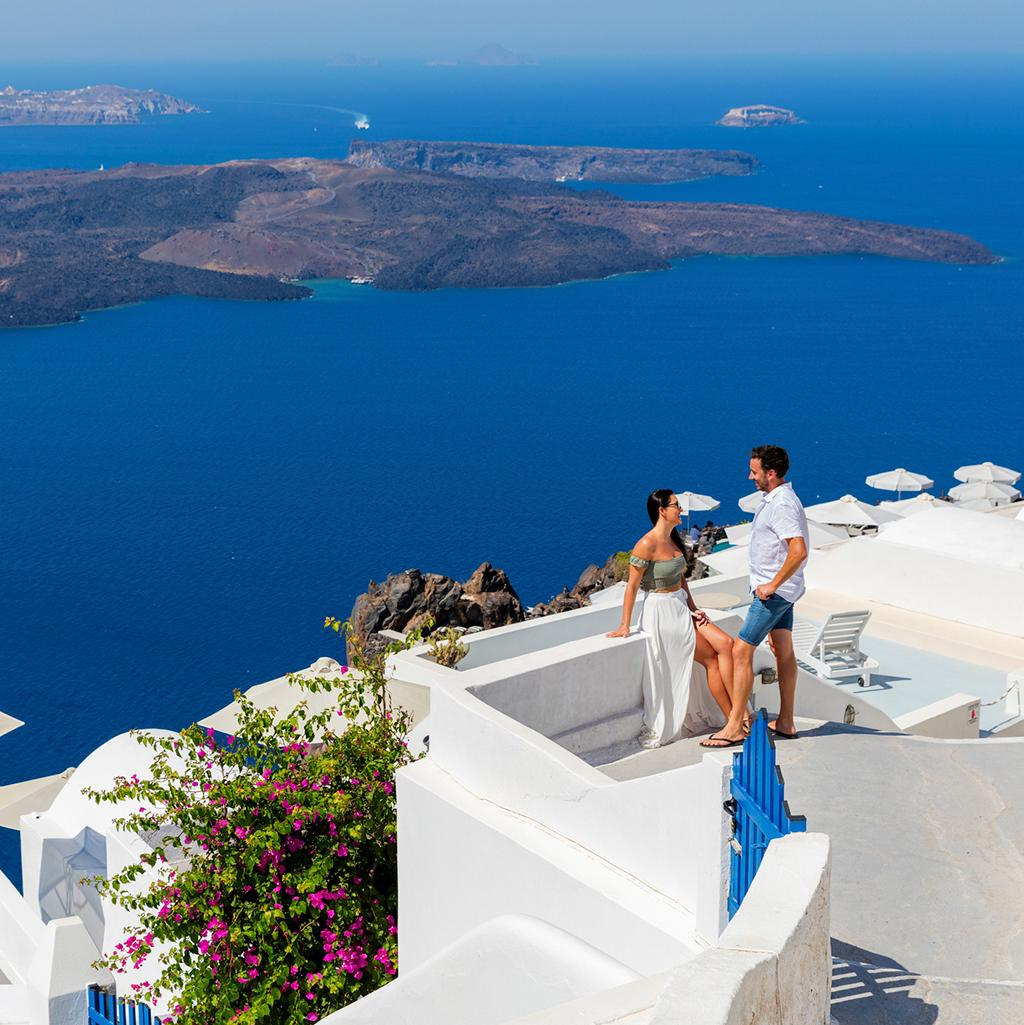 Couple on a Topdeck Tour in Santorini Greece