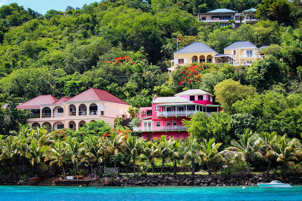 Beautiful colored homes overlooking the water on Tortola's coastline