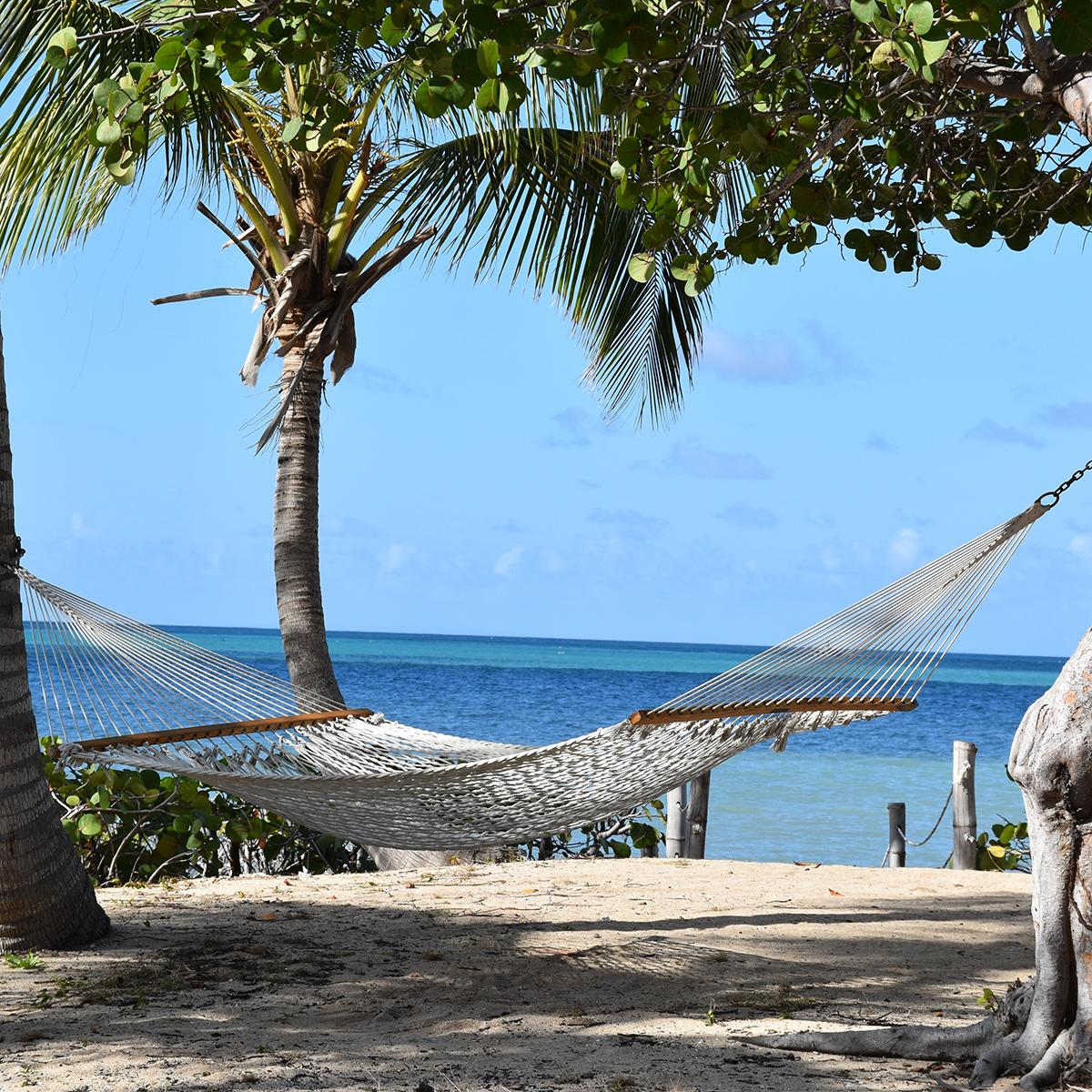 Relax in hammocks by the beach with US Virgin Islands vacation packages