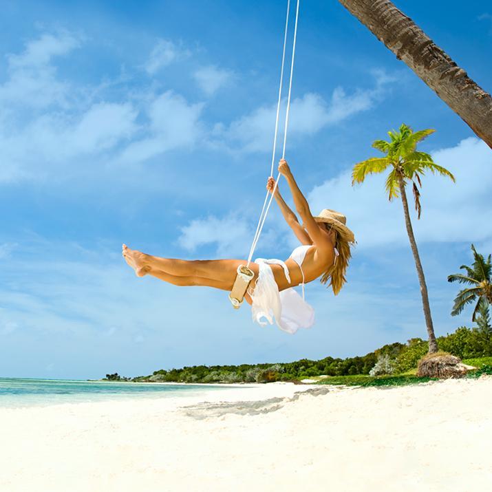 woman on swing on the beach