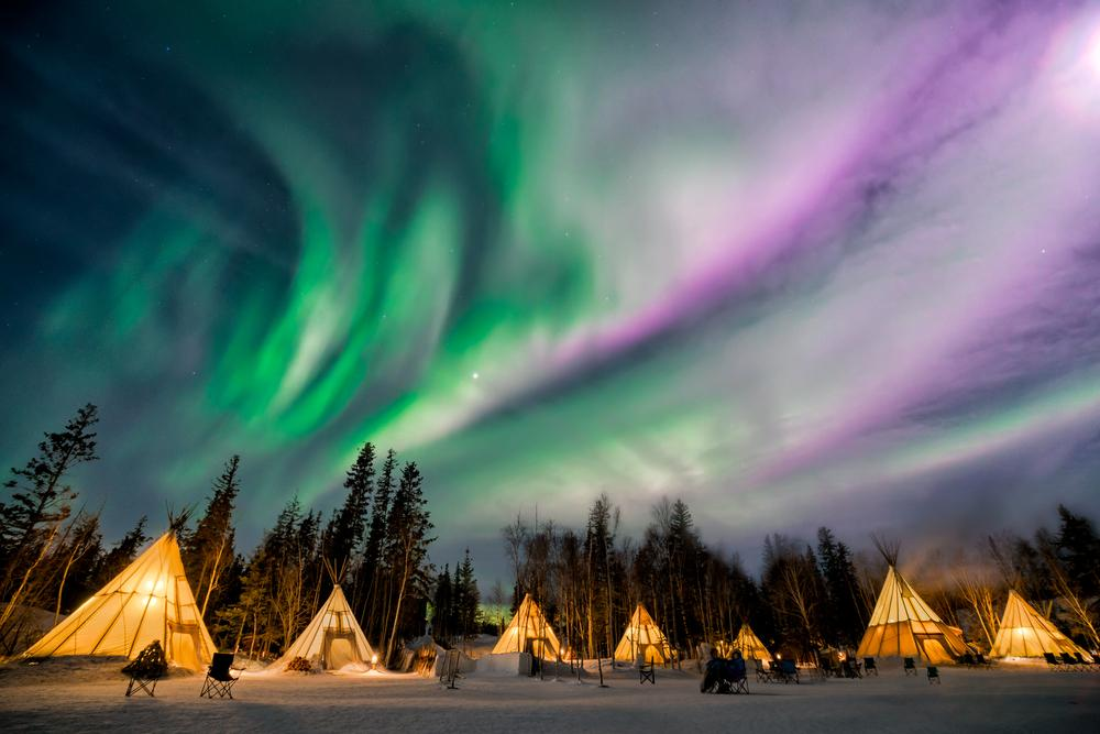Sit under the Aurora Borealis while tipi camping on a Yellowknife tour