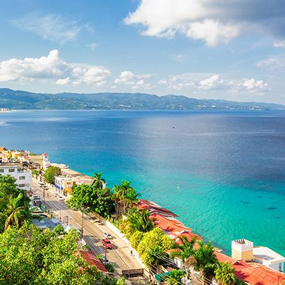 aerial views of the Caribbean Sea and the homes along the coast of Jamaica