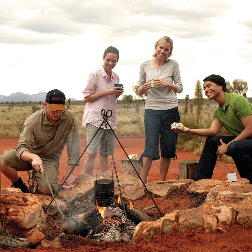 Cooking food on a guided bush walk at Ayers Rock