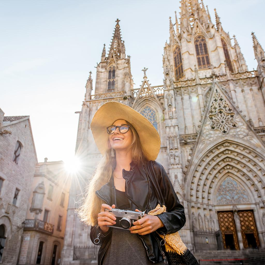 Tourist taking pictures among Barcelona's cathedrals and Spanish architecture